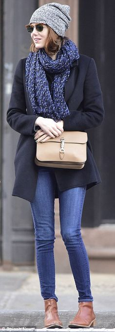 Wrapped up warm: The 26-year-old wore a wool coat, jeans, chunky scarf, ankle boots and beanie hat