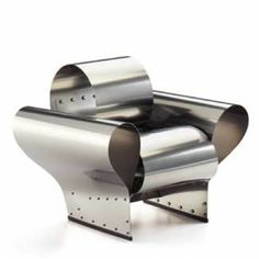Ron Arad Well Tempered Chair- smooth curves but metal bolts. Mixture of clean finishes and industrialism.