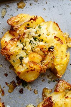 Crispy Garlic Butter Parmesan Smashed Potatoes are fluffy on the inside and crispy on the outside, smothered in garlic butter and parmesan cheese! | http://cafedelites.com