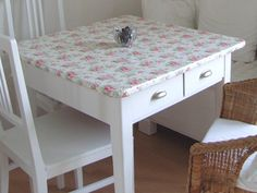 Oil cloth table top, great idea for my porcelain table.
