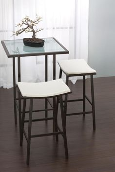 Backless modern saddle style stools from Amisco. Sleek and comfortable!