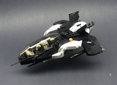 https://flic.kr/p/6fJrCD | Hr-22c Attack Fighter | A more heavily armed variant of the Hr-18, the Hr-22c is intended mainly for attacking capital ships and ground targets. The most noticeable difference is the forward-swept wings, for better handling at low speeds. The Hr-22 also has more sophisticated sensors and is painted black for extra cover in space and at night.  I think I like this better with forward-swept wings. Both fighters exist simultaneously, by the way.