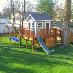 Shed and Outbuilding Before and Afters 2012 This over-the-top, reader-submitted swing set includes a penthouse play space for triplets. This over-the-top, reader-submitted swing set includes a penthouse play space for triplets. Backyard Playhouse, Build A Playhouse, Backyard Playground, Backyard For Kids, Backyard Projects, Playground Ideas, Playhouse Ideas, Play Structures For Kids, Casa Kids