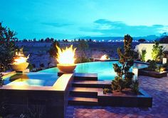 #Fire bowls and fire pit bring warmth to the #pool