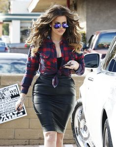 Reality star Khloe Kardashian rocks a tight black leather skirt while filming in Calabasas, California on December 15, 2014. On the latest episode of 'Kourtney & Khloe Take the Hamptons' Khloe's sister Kim recently told her that her booty is huge and that her little sister needs to lose some weight!