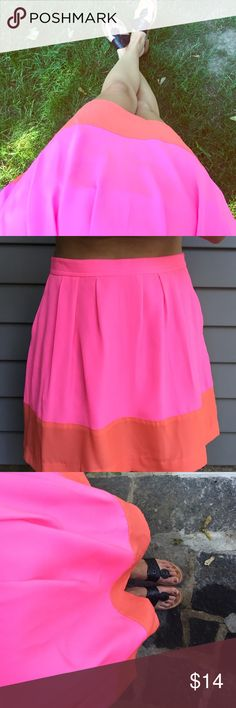 """J. Crew skirt  J. Crew skirt! Bright pink and orange with pockets! Side zipper. Size 2. Only worn once. I'm 5'4"""" and it sits a few inches above my knees. No trades please! J. Crew Skirts A-Line or Full"""