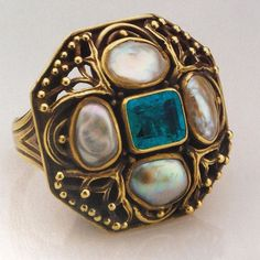 Arts & Crafts ring, c. 1913, by American jeweler Josephine Hartwell Shaw. The ring centers a table cut emerald, framed by four blister pearls, in an organic, branch-like design of 20k gold. Shaw's jewelry garnered her several awards and customers and was even written about in House Beautiful magazine in 1915. She also had the great distinction of taking on Edward Everett Oakes as an apprentice in the early 1900's.