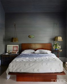 The homeowner made the mahogany platform bed; the candlewicked coverlet is from the 1800s.