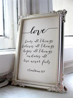 Love bears all things, believes all things, hopes all things, endures all things. Love never fails - verse from 1 Corinthians 13:7.