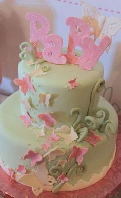 Lovely cake at a pink & mint butterfly baby shower party! See more party ideas at CatchMyParty.com!