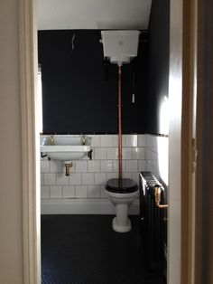 A high level toilet is perfect for achieving a Victorian-inspired aesthetic in your bathroom. Combine with a dark wall colour and white square tiles for a stylish look. Victorian Toilet, Victorian Bathroom, Steam Showers Bathroom, Small Bathroom, Bathroom Colors, Bathroom Ideas, Wc Retro, Eclectic Bathroom, Industrial Bathroom