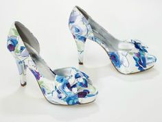Feminine and chic, this satin peep toe is the must-have #shoe of the season in a pretty blue floral print. Style GardenParty: http://bit.ly/zsIS8a