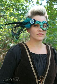 Czech glass and peacock feathers?  Yes, please!  One-of-a-kind asymmetrical mask by ArtisanMaskers (on Etsy).