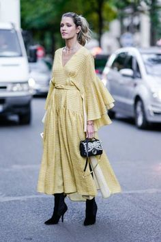 ☆Helena Bordon wears a yellow dress and black boots outside the Fendi show during Paris Fashion Week Haute Couture Fall/Winter 20172018 on July 5 2017...
