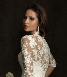 Long-sleeved lace wedding dresses are a sophisticated yet classic winter look. #winter wedding #wedding dress