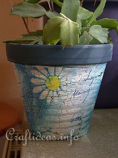 Terra cotta pot, paint, crackle paint, napkins and modge podge