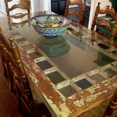 Old glass door and porch spindle dining table... the glass part is growing on me...