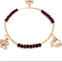 Three Elephant Purple Bracelet. Triple your luck with this adorable (3) elephant purple bracelet. The elephant is a symbol of good luck and warding off evil energy. Brand New. Unknown Jewelry Bracelets