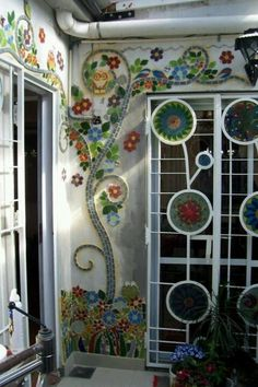 Mosaics on home wall and glass flowers