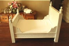 Baby doll bed.... add curtain rod ends to top of regular baby doll bed and perhaps slim corbels to head and foot of bed.