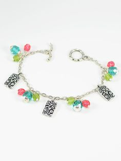 Bracelet 1252 - A sweet and simple antique silver charm bracelet that features blooming lotus charms paired with teal, green tea and raspberry faceted Czech beads.