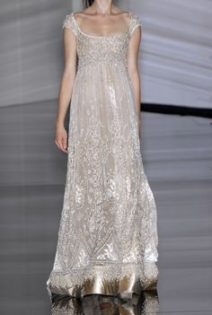 A lovely neckline on this beaded gown with crystal embroidery.
