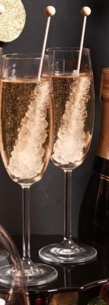 Champagne and Rock Candy makes for the ultimate party drink. Love this idea for a New Year's celebration!