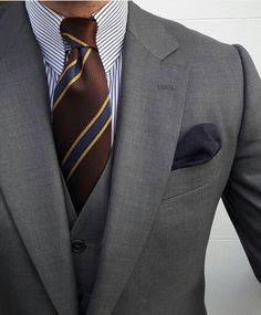 Good use of stripes and proportion to balance a formal business professional look.