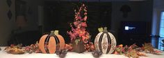 simple fall decor with a fall arrangement, pumkins, leaves and turkey votives