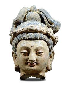 HEAD OF THE BODHISATTVA MAITREYA  Gandhara - North Pakistan/Afghanistan - Art of Gandhara - 4th century  Polychrome unbaked earth - H. 28 cm (11'')