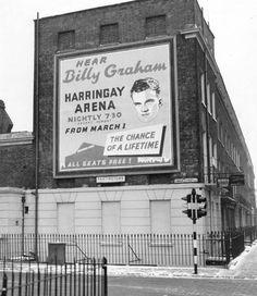 Billy Graham poster on Camden Street, London, 1954. (I remember the tent camp meets with him and a lot of other preachers in the 1940s and 1950s)