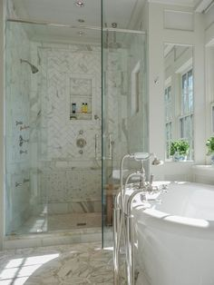 Fabulous bathroom with BainUltra Balneo Naos Bathtub accented with polished nickel floor-mounted tug filler over intricate laser-cut calcutta gold marble inlay flooring.