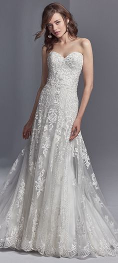 Skylar by Sottero and Midgley features unique lace motifs in a chic silhouette.