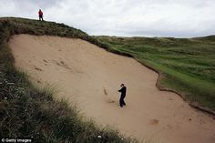 Tom Watson plays out of the huge bunker 'Big Nellie' at the 17th hole on the Dunluce Course at Portrush