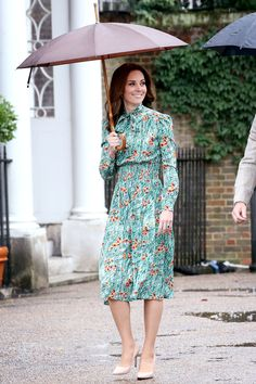 The Duchess chose an elegant green Prada tea-length dress ($2,340; matchesfashion.com) with a high neck and long sleeves for a visit to Princess Diana's memorial garden with Princes William and Harry.
