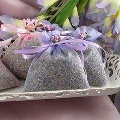 Sheer sachets of lavender, tied with a ribbon. We are planning to make these for guests to throw lavender (instead of rice) after the wedding. It will smell heavenly!