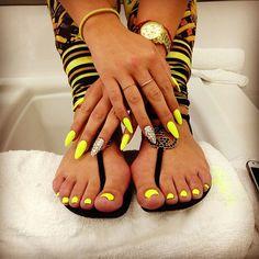 Neon yellow talon nails w/ matching pedi. Super daring and youthful!