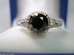 There is just a mysterious something about black diamonds... from Jewelry by Garo on Etsy.