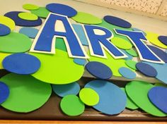 "This is my art room sign above my door made from Fun Foam. So I like to get a few things done for ""next year"" (which is really less than 2 months away) at the end of ""this year""! With our special area team all on board for doing a ""global theme""...I decided blues & greens would be a great choice for my room! (I change my color theme every year...I have enough fabric so I can have 7 yrs in a row be different if I want to...warm colors..cool colors..primary..etc."