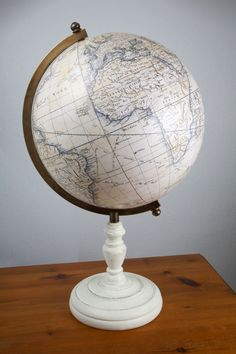 globemakers Lander and May present their handmade  Delamarche 13 inch terrestrial globe with tripod stand