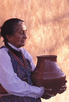 Born at Santa Clara Pueblo around 1904, Margaret Tafoya created pottery that was incredible in its size and form, and degree of perfection. Instead of painting her work, she conceived of a direct carving method for decorating redware and blackware.