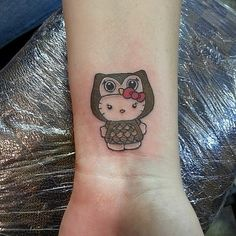 Pin for Later: The Cutest, Most Creative Hello Kitty Tattoos Owl Kitty Owl Tattoo Small, Small Tattoos, Cat Tattoo, Tattoo You, Body Art Tattoos, Sleeve Tattoos, Geek Tattoos, Owl Tattoos, Tatoos