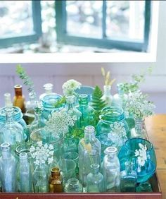 Morning light shining on array of aqua and turquoise bottles... So pretty.