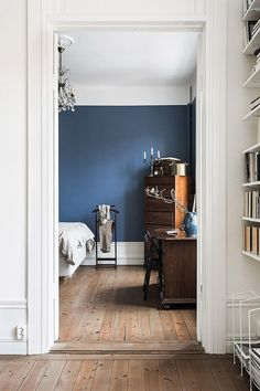 tall ceilings with bold blue wall color. / sfgirlbybay