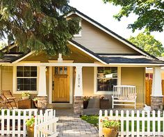 A classic white picket fence complements a Craftsman-style home. Update your home with our 12 month home improvement plan: http://www.bhg.com/home-improvement/month-by-month-home-improvement-plan/#page=1