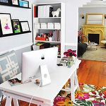 dens/libraries/offices - white sawhorse desk blue overlapping squares pillow white bookcase chair rail blue gray walls paint color black floating shelves floral rug art white storage boxes gray office