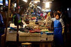 Life at the Original Noryeongjin Fish Market ... A vendor grabs a string of octopi for a customer at Koreas largest fish market in Seoul. . . . . #Seoul #fishmarket #korea #travel #seafood #ig_seoul #ig_korea #food #market #life #history #old #VisitSeoul #natgeotravel #bbctravel #cntraveler #thedecisivesketch #octopus