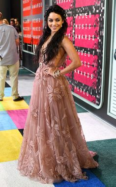 Vanessa Hudgens from 2015 MTV Video Music Awards Red Carpet Arrivals  Sticking with her go-to bohemian style, the High School Musical alum is breathtaking in this ethereal blush-colored gown.