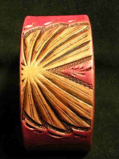 Tooled leather pink cuff by AcrossLeather on Etsy, $40.00