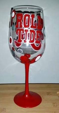 """This is a 19 oz hand painted Alabama Crimson Tide """"Roll Tide"""" wine glass. The glass has a red and white script A painted on one side and """"Roll Tide"""" on the other side with a red stem. The glass is acc                                                                                                                                                     More"""